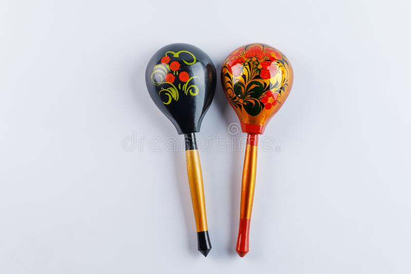 Two spoons with a traditional pattern. Wooden spoons with floral ornament in traditional folk Russian Khokhloma style on a wooden stock photography