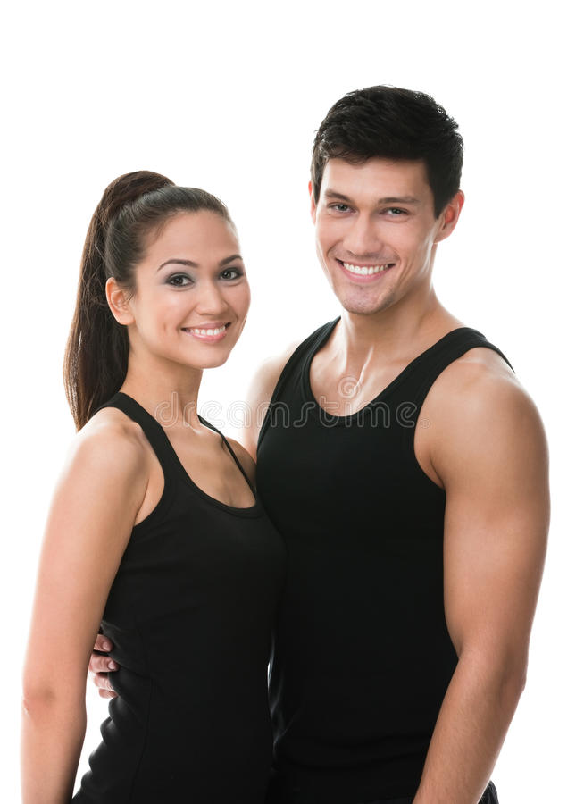 Download Two Sportive People In Black Sportswear Embrace Stock Photo - Image: 28882382