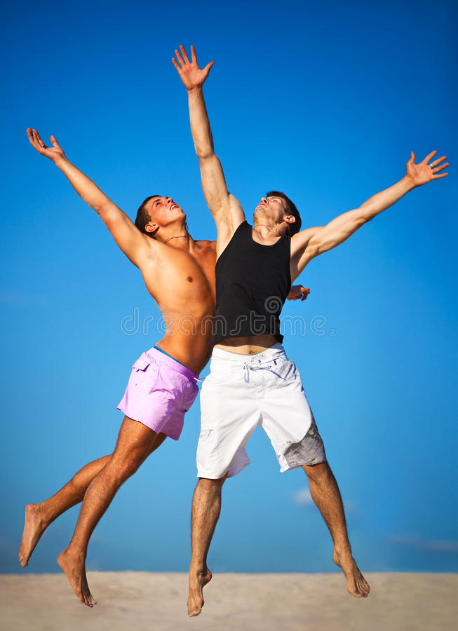 Two sportsmans jumping. Up high stock photography