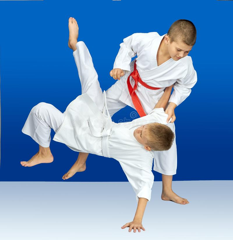 Sportsmens are training judo throws stock photography