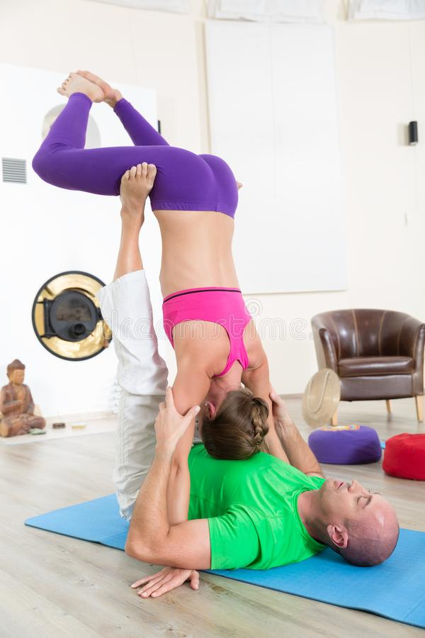 Sporty people practicing yoga lesson stock photos
