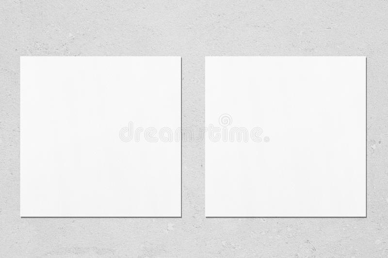 two square flyer or business card mockups on light grey concrete background stock images