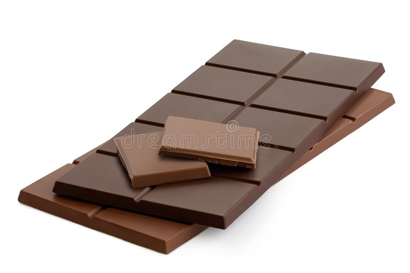 Two squares of milk chololate on top of dark chololate and milk chocolate bars. Isolated on white.  stock image