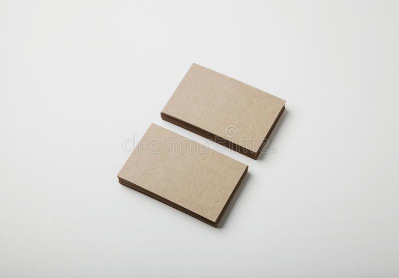 Two stack of blank craft business cards on white background with soft shadows. Horizontal stock photo