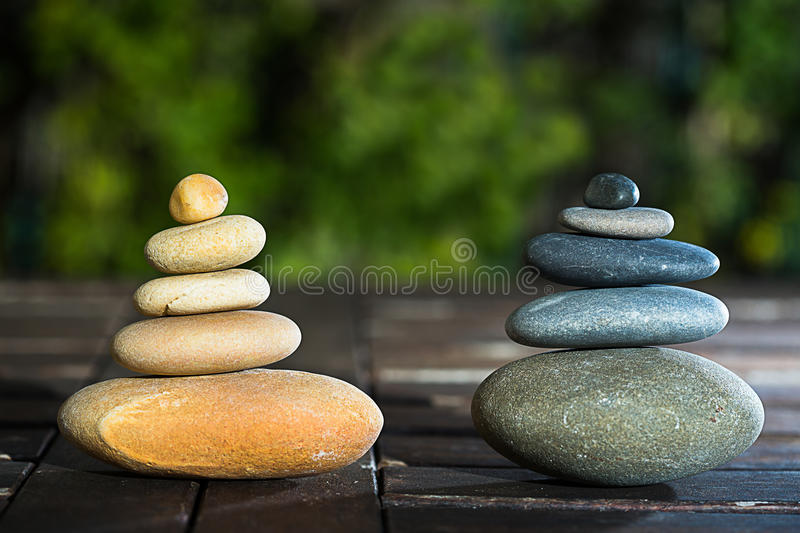 Two stacking of stones. Kerns of two different colors representing a couple stock photos