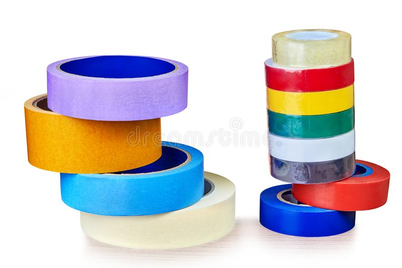 Two stacks colorful rolls of duct tape, on white. stock image