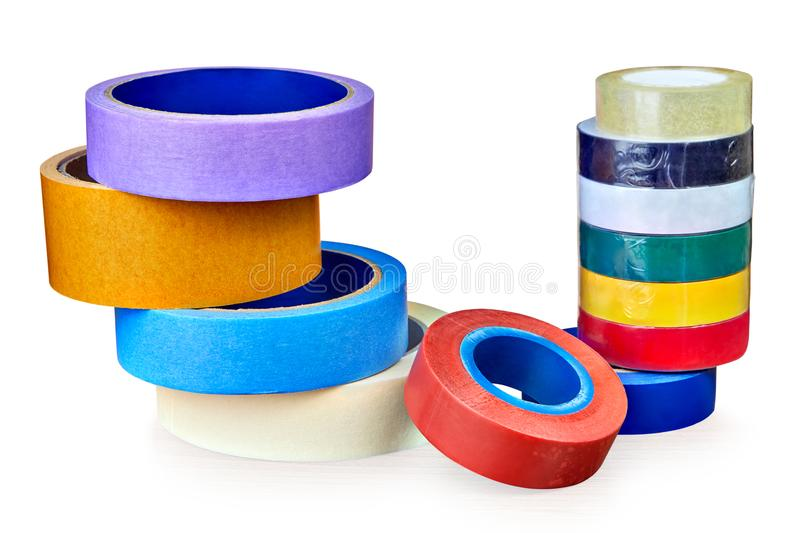 Two stacks of rolls of multi-colored adhesive tape, on white. royalty free stock images