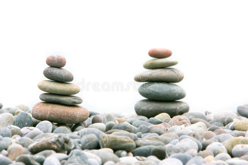 Two Stacks Of Stones Over White Royalty Free Stock Images