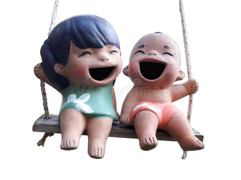 Two statuettes of funny boy and girl stock image