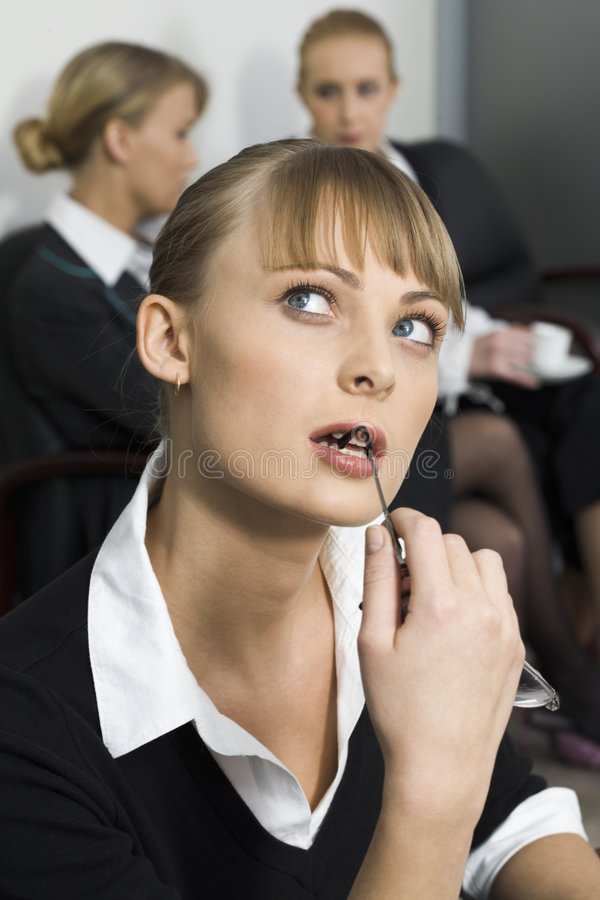 Two steps forward. Cute blond woman is thinking over the situation stock photo