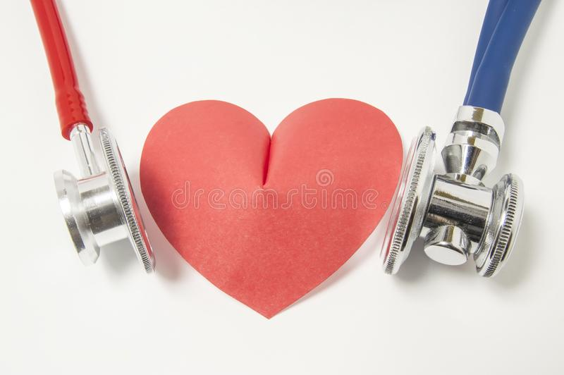 Two stethoscope blue and red are examined listening or auscultation heart shape left and right side on white background. Detai stock photo