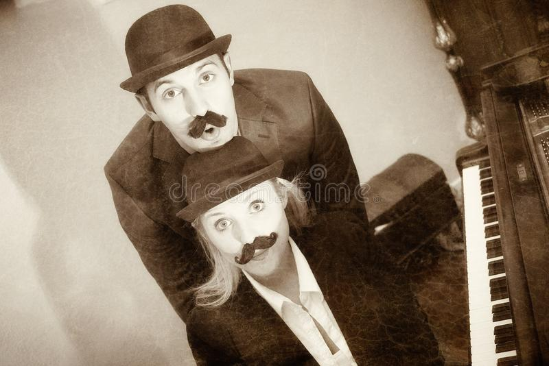 Two stooges. A comedy duo or stooges in retro style royalty free stock photos