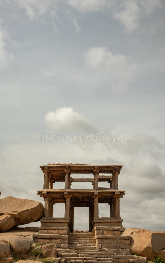 Two-storeyed mantapa or double-storeyed gateway in the south west of the Vitthala temple, Hampi, India royalty free stock photo