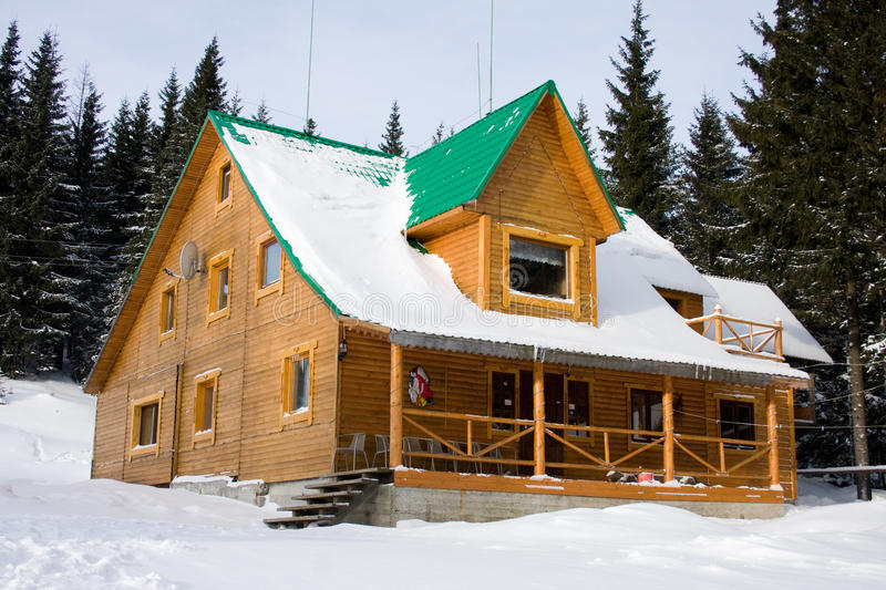 Two-storeyed wooden house concealed by snow stock photo