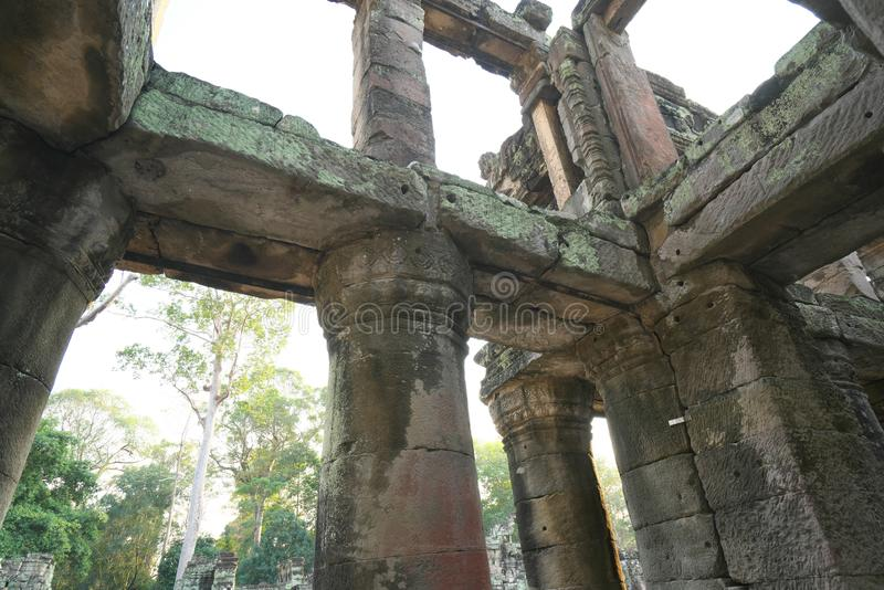 A two-storied temple with round columns in Preah Khan, Siem Reap, Cambodia. Siem Reap,Cambodia-Januay 12, 2019: A two-storied temple with round columns in Preah royalty free stock photography