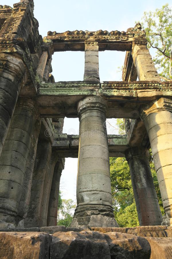 A two-storied temple with round columns in Preah Khan, Siem Reap, Cambodia. Siem Reap,Cambodia-Januay 12, 2019: A two-storied temple with round columns in Preah stock photos