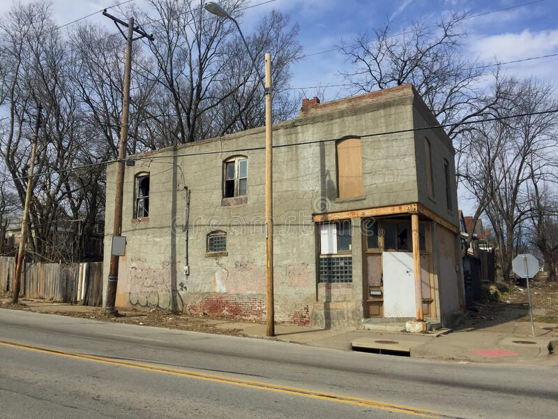 Two story abandoned business front view angled stock photography