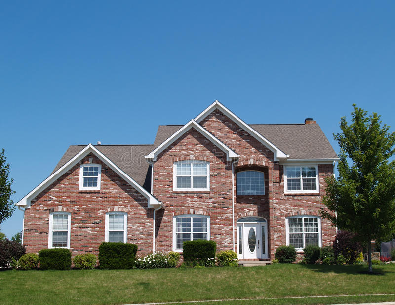 Two Story New Brick Residential Home. With side garage and plenty of copy space stock photography