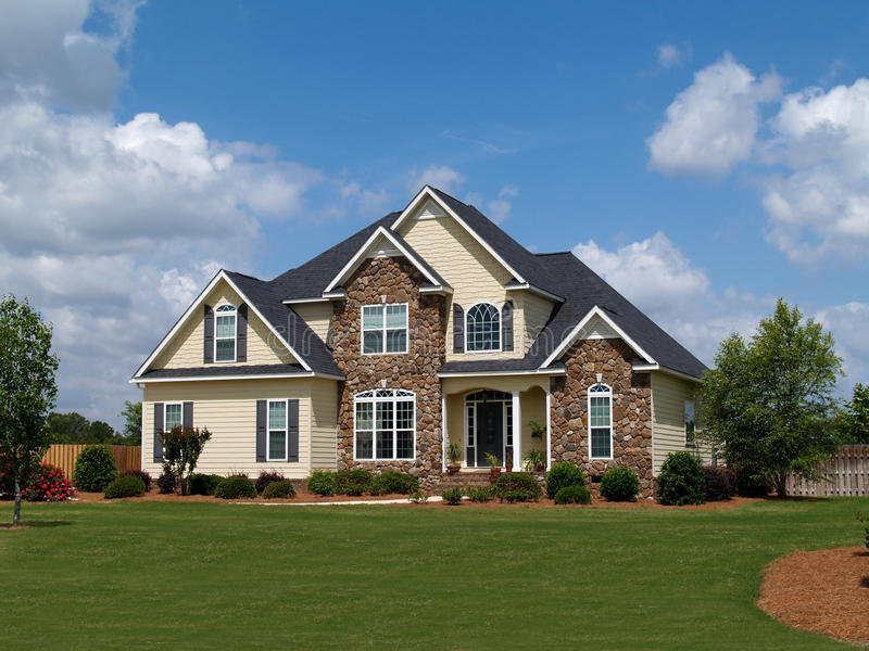 Two Story Residential Home. With both stone and board siding on the facade stock photography
