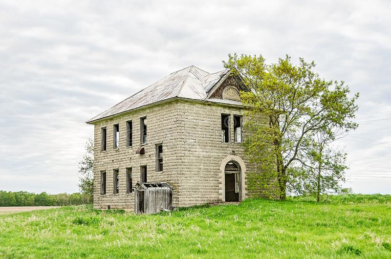 Two-story School Built in 1906. Old, abandoned two-story school built in 1906 brings back memories for people who attended similar schools stock image
