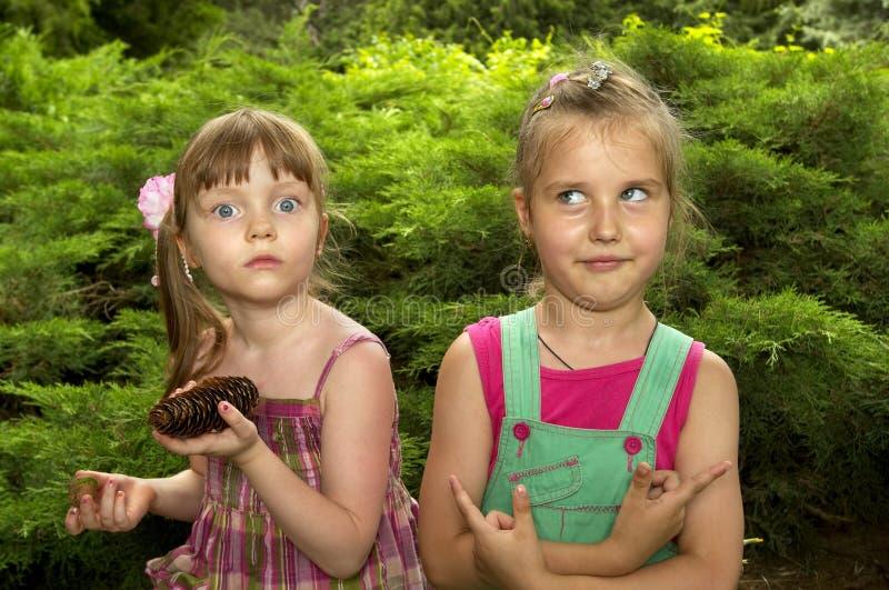 Two strange little girls royalty free stock photos