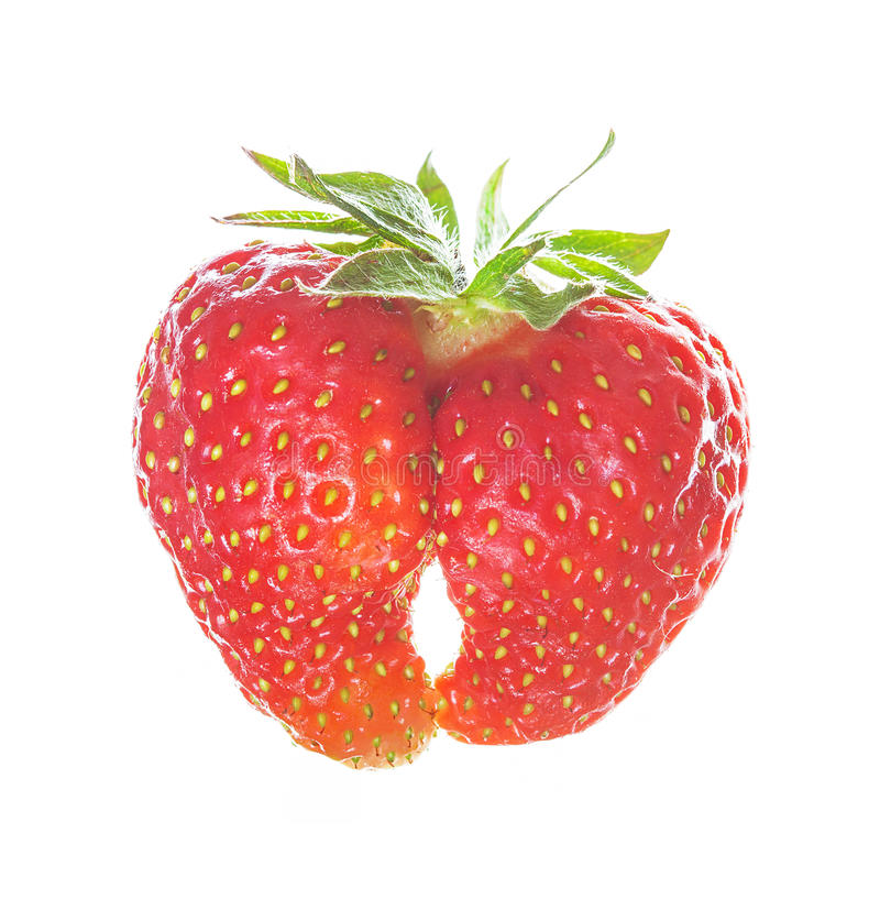Two strawberries joined by nature into one. Heart shape, symbol of love. royalty free stock photography