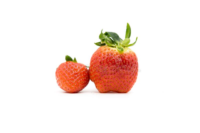 Two strawberry is on a white background. stock photography