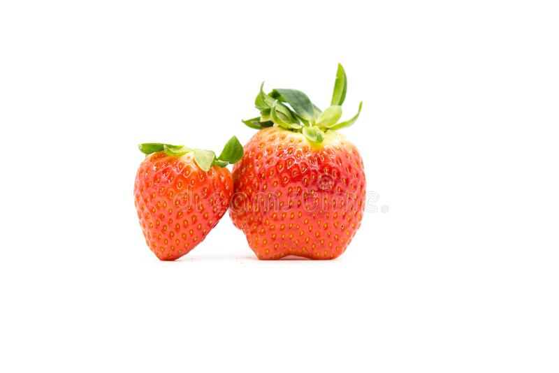 two strawberry is on a white background. royalty free stock photo
