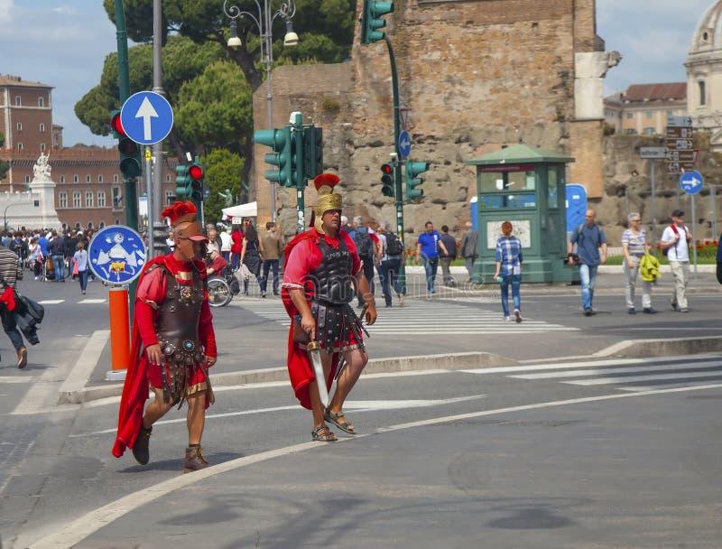 Two street actors in Roman legionary armor stock image