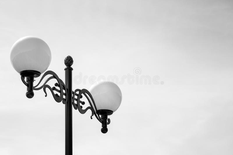 Two Street Lamps on Black Lamp Stand. Black and White Photo. Minimal Details stock image