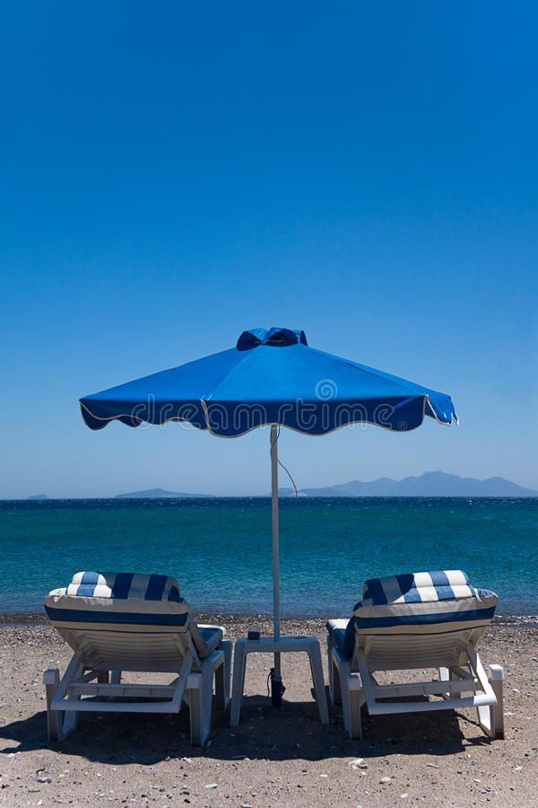 Free Two Stripped Blue Beach Chairs With Sea View Stock Photos - 10356183