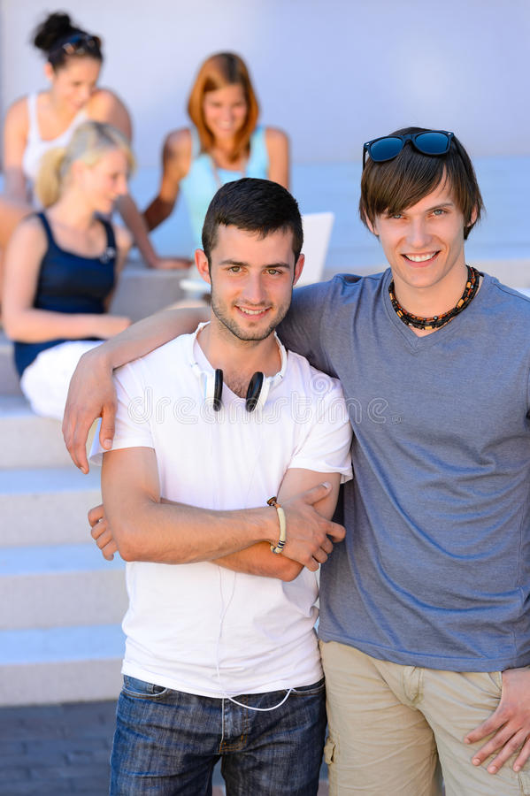 Two student boys standing outside college summer stock photography