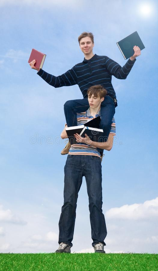 The two students with the book royalty free stock photography