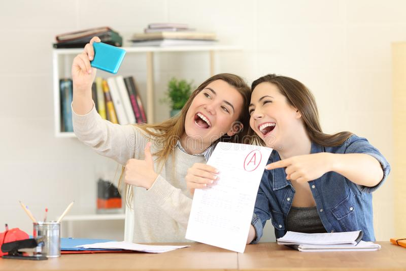 Two students celebrating exam approval stock photos
