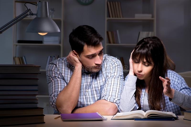 The two students studying late at night royalty free stock image
