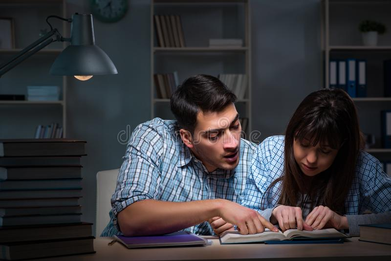 The two students studying late at night royalty free stock photo