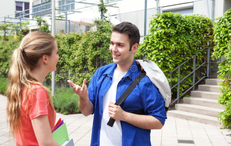 Two students talking on campus royalty free stock photography