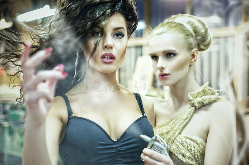 Two stunning ladies in an old manufactory royalty free stock image