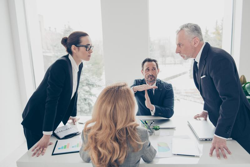 Two stylish business persons in suits having disagreement, war, stock images