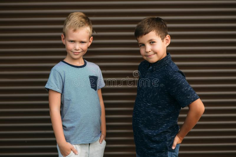 Two stylish childrend posing to the photograher royalty free stock photo