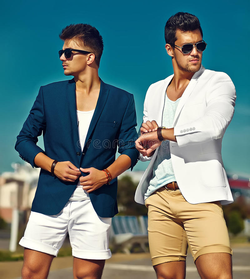 two stylish confident handsome men in the street stock photos