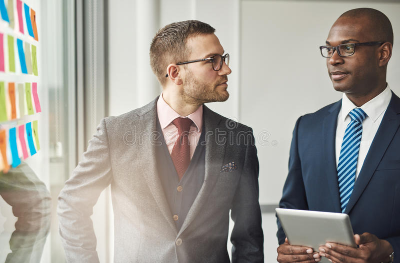 Two stylish corporate executives in a discussion royalty free stock images