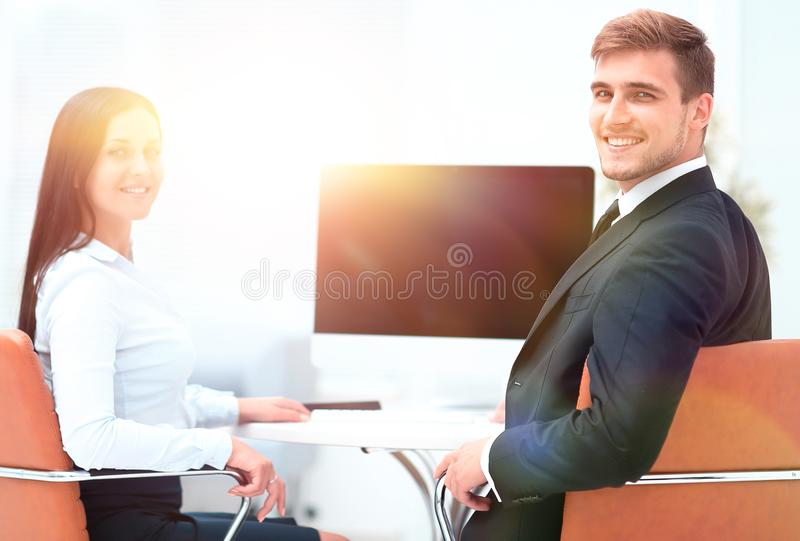 Two successful employee sitting behind a Desk. And looking at camera. photo with copy space stock photos