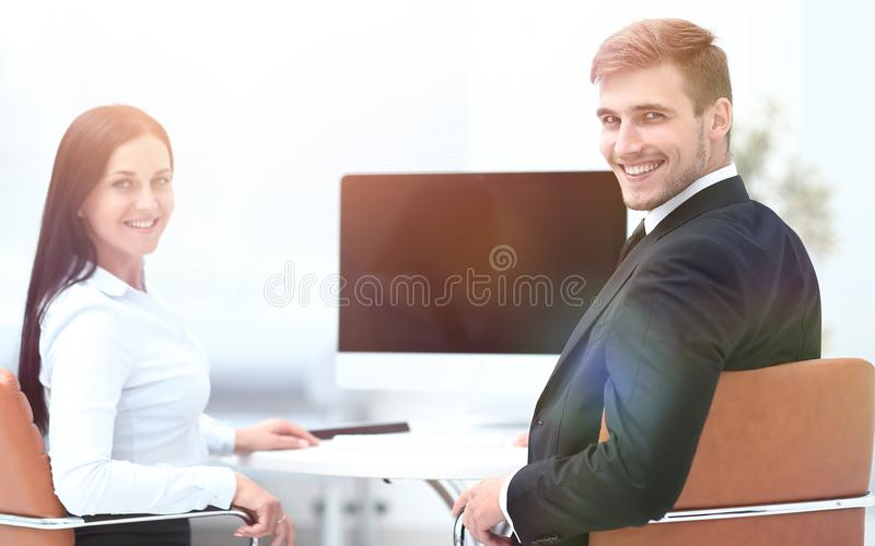 Two successful employee sitting behind a Desk. And looking at camera. photo with copy space royalty free stock photography