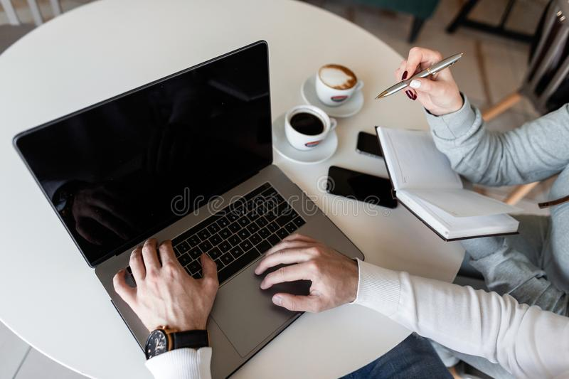 Two successful professionals a man and a woman are looking for ideas online for their business project. stock images