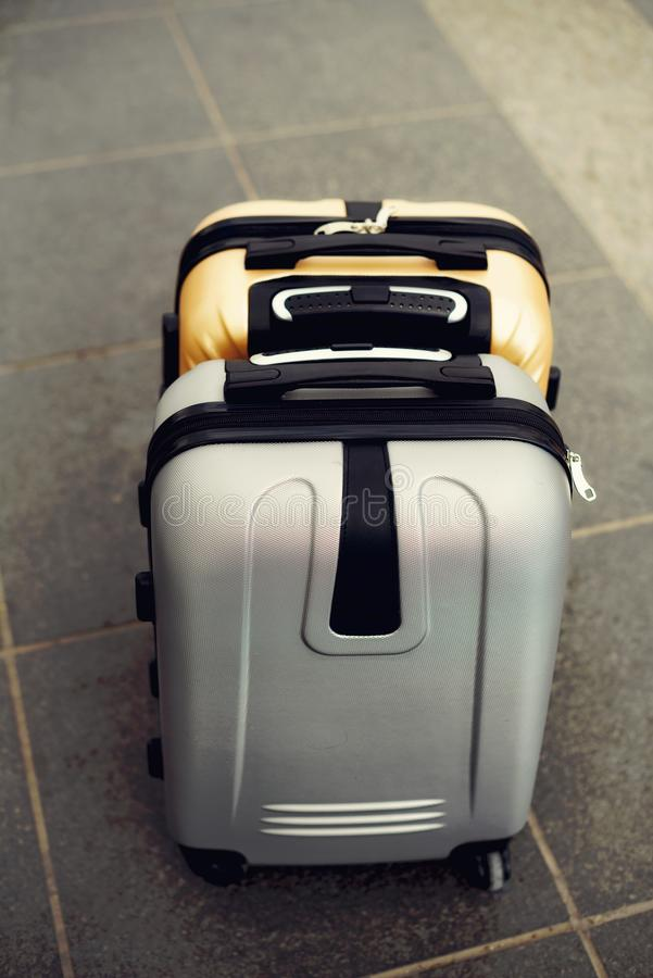 Two suitcases on grey blurred background. Summer vacation and travel concept. Traveler suitcase with copy space.  royalty free stock photography