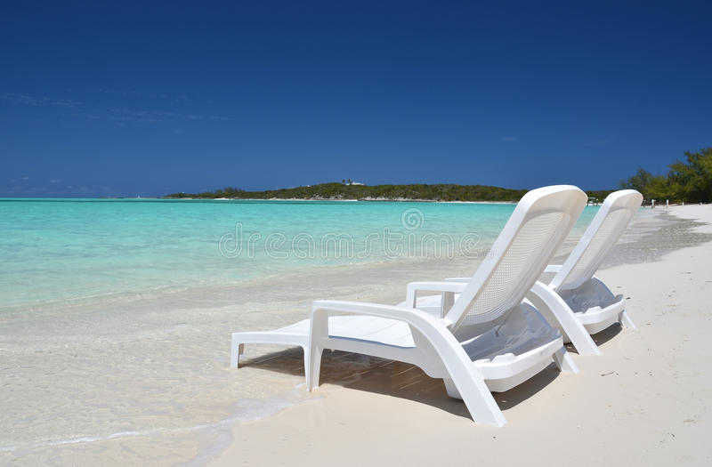 Two sunbeds. Exuma, Bahamas. Two sunbeds overlooking Atlantic. Exuma, Bahamas royalty free stock photos