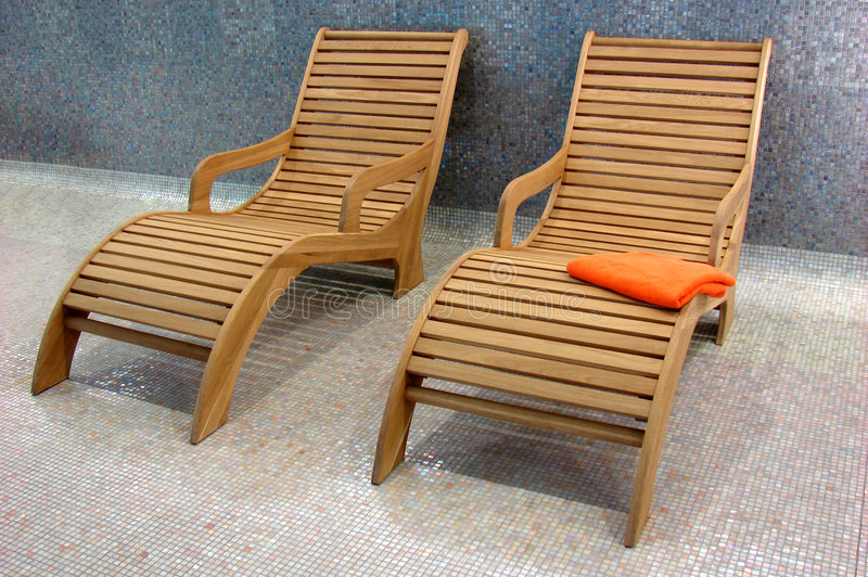 Two Sunbeds in the fitness wit. H one orange towel royalty free stock photos