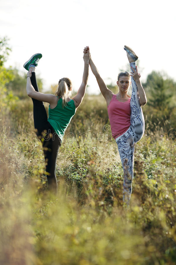 Two supple athletic women working out together stock photo