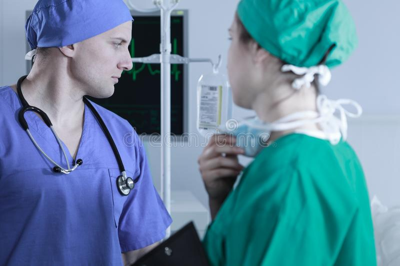 Two surgeons in sterile scrubs stock photo